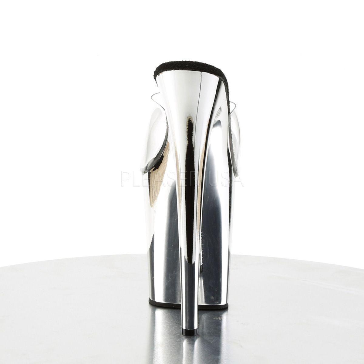 Exóticos zuecos de plataforma alta cromada y empeine transparente